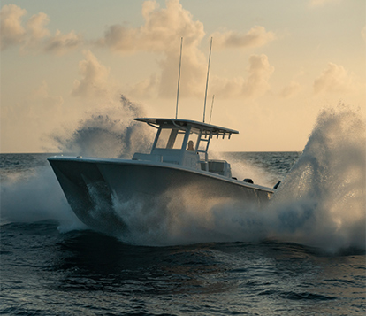 Invincible Boat's 35 foot compact catamaran speeding through waters.
